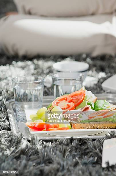 Plate with grapes, tomatoes and bread roll