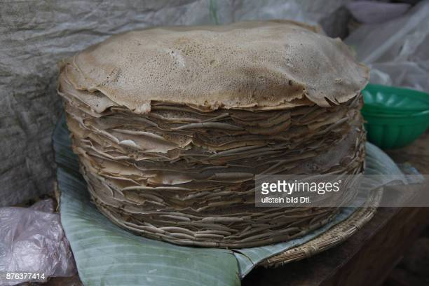 A plate with injera made of teff flour it is the national dish and staple diet of Ethiopia