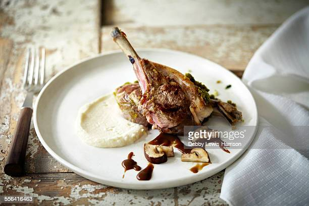 plate with lamb chop, gravy and mashed potato - gravy stock photos and pictures
