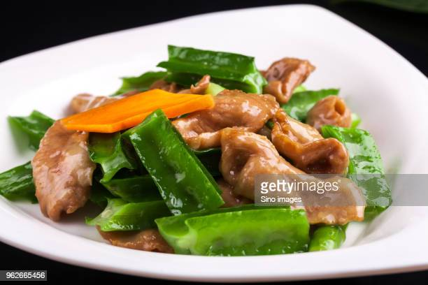 plate with moo goo gai pan - image stock pictures, royalty-free photos & images