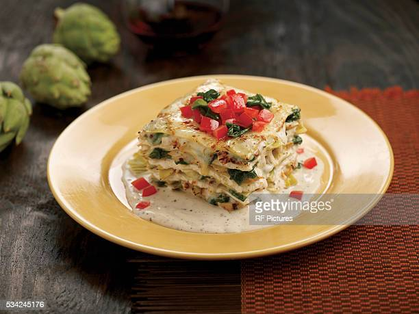 plate with piece of lasagna - lasagna stock pictures, royalty-free photos & images