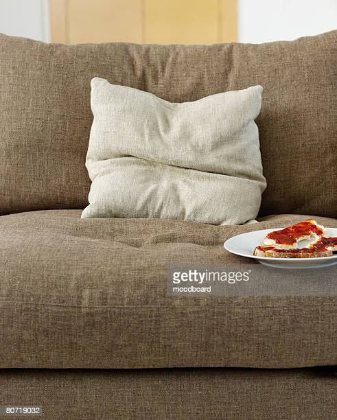 plate with sandwiches on sofa - cushion stock photos and pictures