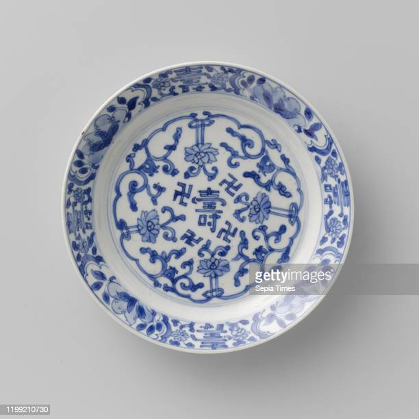 Plate with 'shou' character and stylized lotus scrolls, Porcelain plate with short wall and beveled edge, painted in underglaze blue. On the flat the...
