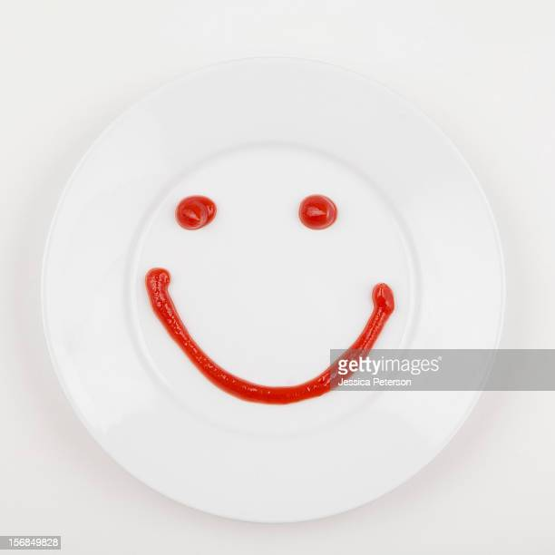 Plate with smiley face made of ketchup