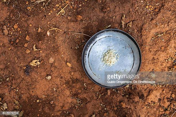plate with some rice on dry african soil - un food and agriculture organization stock pictures, royalty-free photos & images