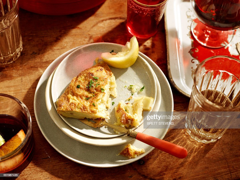 Plate with spanish omelette and lemon : Stock Photo