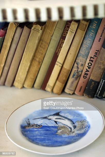 A plate with the painting of a Blue Marlin swordfish lies on a bookshelf of the Ernest Hemingway house at the Finca Vigia on November 11 2002 in...