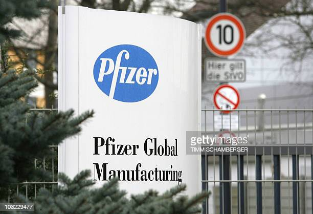 A plate with the Pfizer logo is seen at the entrance of the plant in Feucht near Nuremberg southern Germany 23 January 2007 one day after the US...