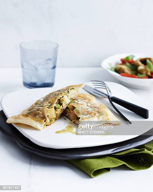Plate with tuna and egg briks and side dish