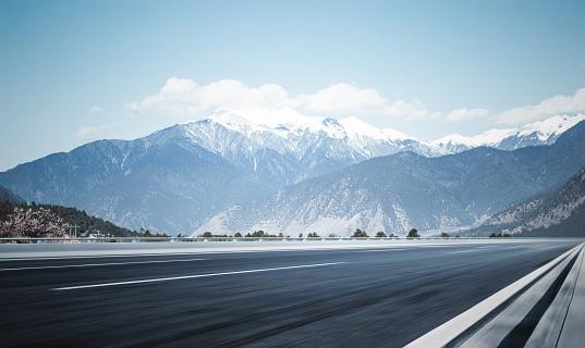 plateau road to snow mountains,Tibet - gettyimageskorea