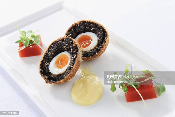 plated black pudding scotch egg appetizer
