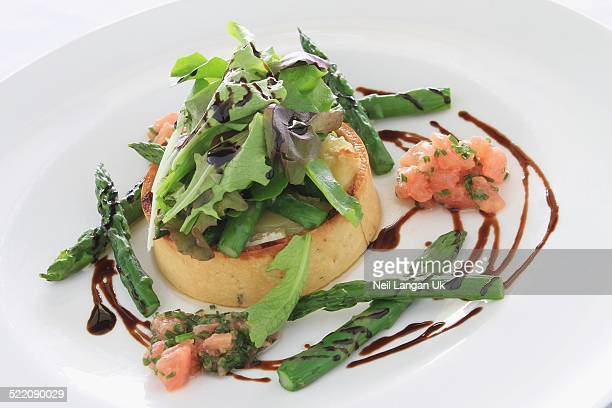 plated cheese quiche with asparagus salad