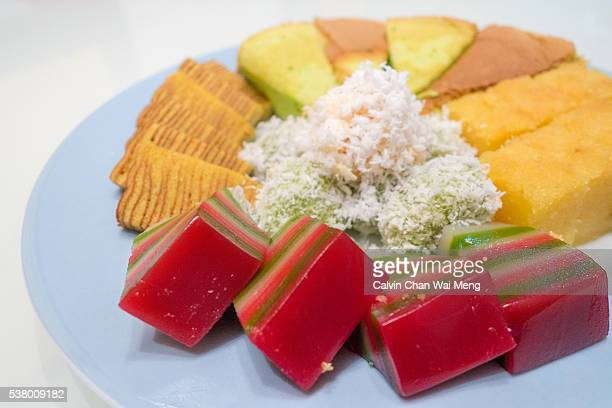 a plated of assorted nonya snacks and cakes - シンガポール文化 ストックフォトと画像