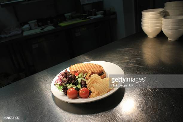 plated panini in restaurant kitchen