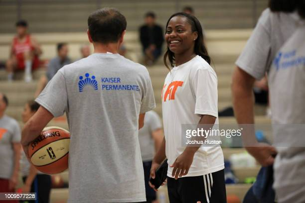 WNBA plater Ivory Latta chats with a participant of the WNBA's Fit Clinic on JULY 21 2018 at Olympia High School Olympia Washington NOTE TO USER User...