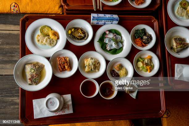 Plates and dishes of Korean food at the Andong traditional village The Hahoe Folk Village is a traditional village from the Joseon Dynasty The 'Ha'...