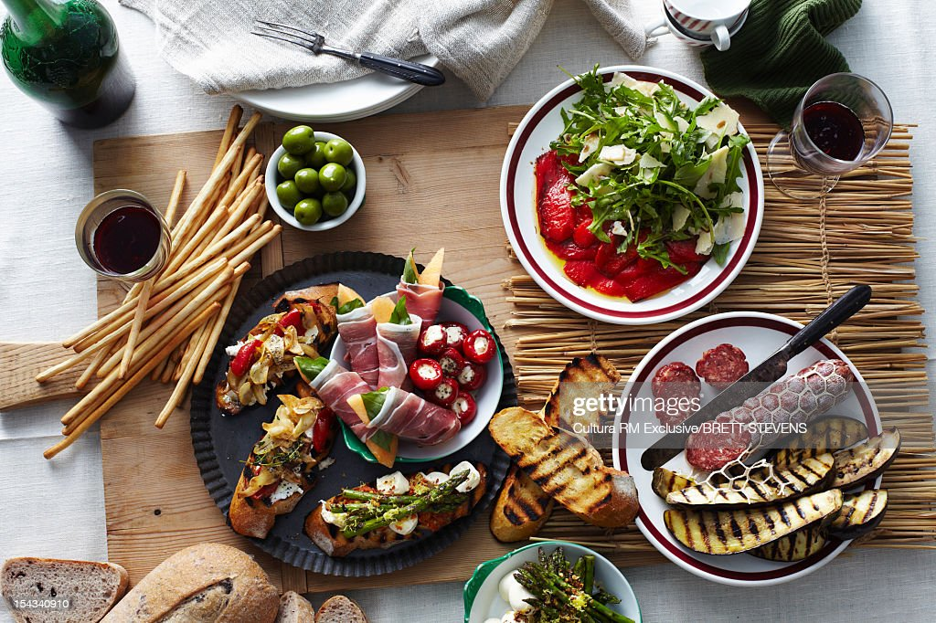 Plates of bread, meats and vegetables : Stock Photo
