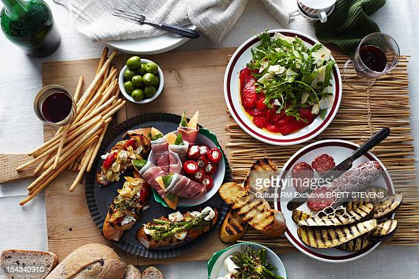Plates of bread, meats and vegetables