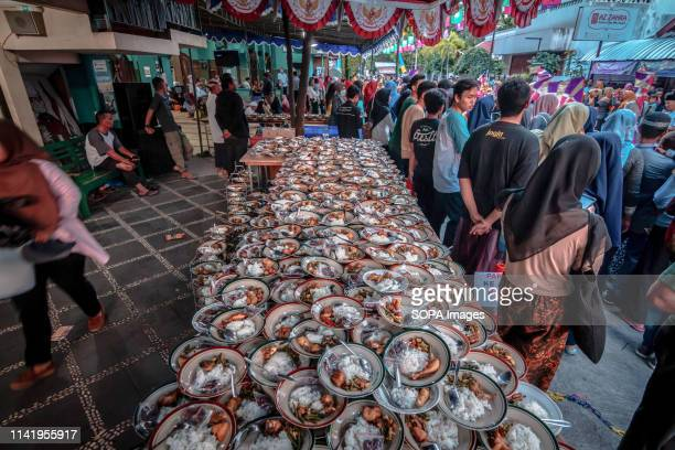 Plates of food of Indonesian Muslims gathered for iftar dinner seen during the holy month of Ramadhan at Jogokariyan Mosque in Yogyakarta Indonesia...
