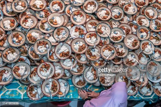 Plates of food of Indonesian Muslims gathered for iftar dinner seen during the holy month of Ramadhan at Jogokariyan Mosque in Yogyakarta, Indonesia....