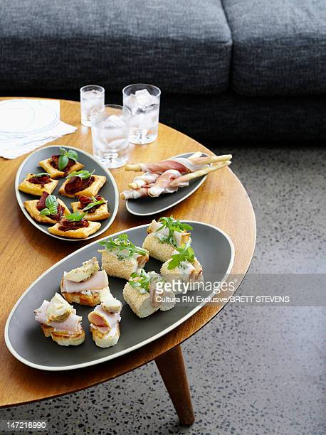 Plates of hors doeurves on coffee table
