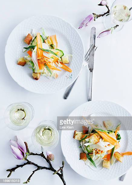Plates of pasta with vegetables