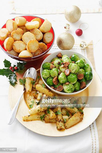 Plates of potatoes and brussels sprouts
