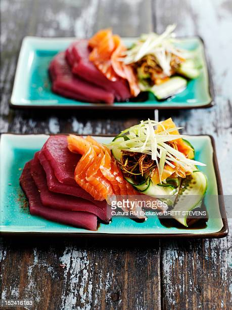 Plates of raw meat with vegetables