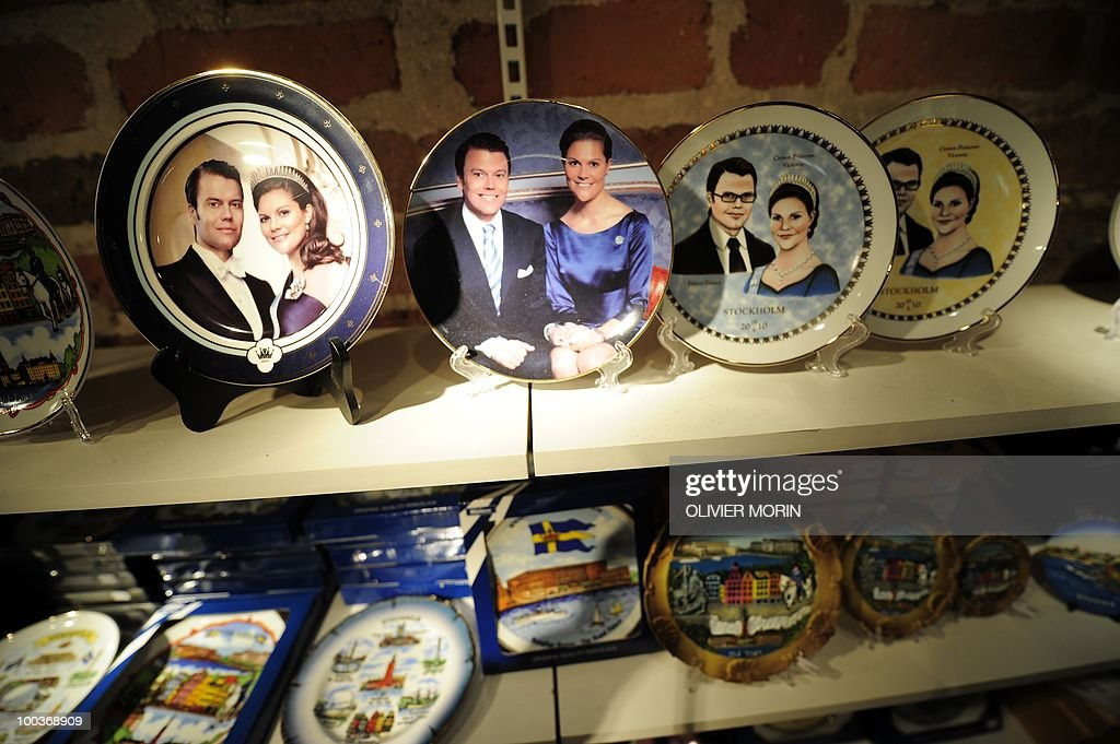 Plates of Swedish crown Princess Victoria and her fiance Daniel Westling (Top)are displayed for sale in a souvenir shop near the Royal Castle in Stockholm on May 24, 2010, where the royal wedding will be held. Many tourists paid a visit to the Swedish capital less than a month before Crown Princess Victoria 's wedding, the 32-year-old eldest daughter of King Carl XVI Gustaf.