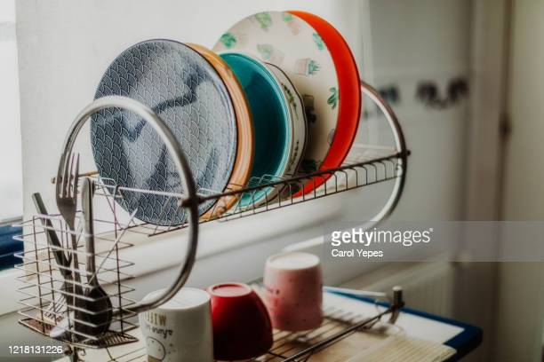 plates on drying board at the kitchen - 洗う ストックフォトと画像