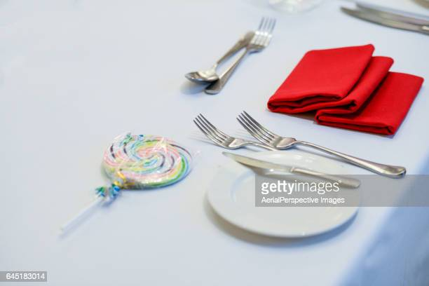 Plates on White Tablecloth