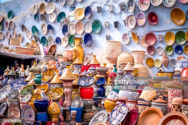 plates, tajines and pots. moroccan cookware on the market - artisanal food and drink stock pictures, royalty-free photos & images