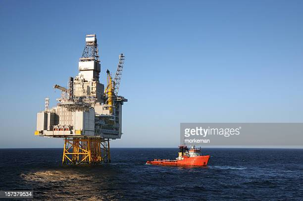 platform and boat - north sea stock photos and pictures