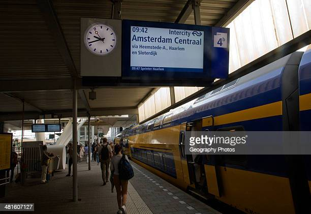 Platform electronic display for Intercity train departure to Amsterdam Centraal Leiden Central railway station Netherlands