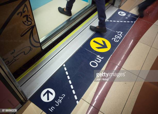 Platform markings indicating boarding zones on the Dubai Metro.