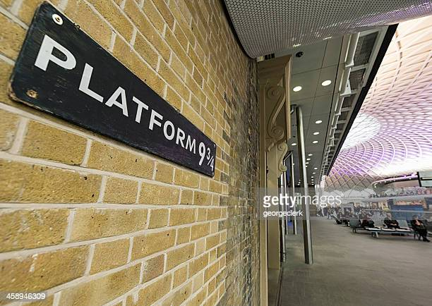 platform nine and three quarters at king's cross station - three quarter length stock pictures, royalty-free photos & images