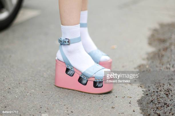 Platform pink and blue sandals are seen outside the Chanel show during Paris Fashion Week Womenswear Fall/Winter 2017/2018 on March 7 2017 in Paris...