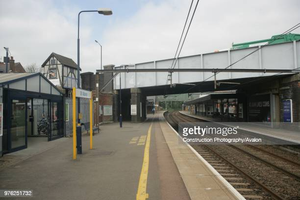 Platform view at St Albans City station Hertfordshire showing the exit to the car park on the left hand side and the road bridge 3rd May 2007