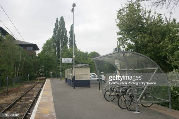 Platform view towards the buffers at St Albans Abbey station showing platform lighting and shelters for passengers and bicycles 2007