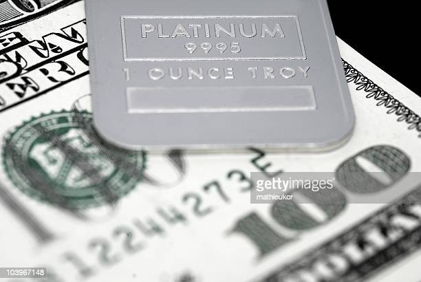 Platinum ingot and US currency
