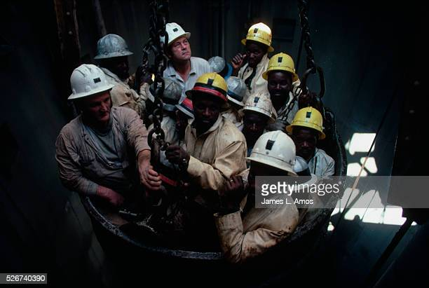 Platinum mine workers ascend from shaft nine of the Wildebeestfontein platinum mine in a bucket elevator Republic of South Africa