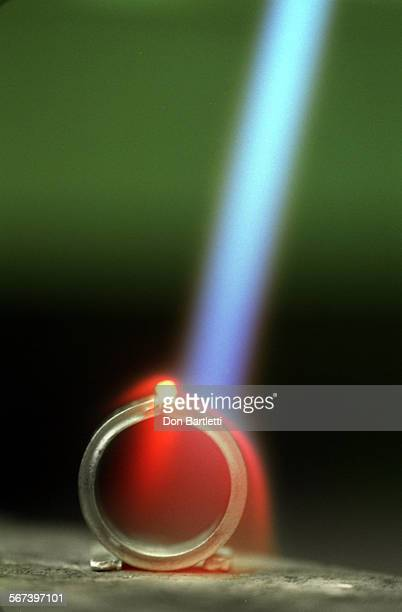 LSPlatinumWeldDB6/12/97NewportBeach Nearing the 3000–plus–degrees at which it melts a bead of platinum glows white–hot under the blast of the welding...