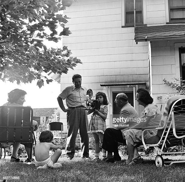 Platnick family among them US Army/Signal Corps photographer Ray Platnick in yard with cameras 1948