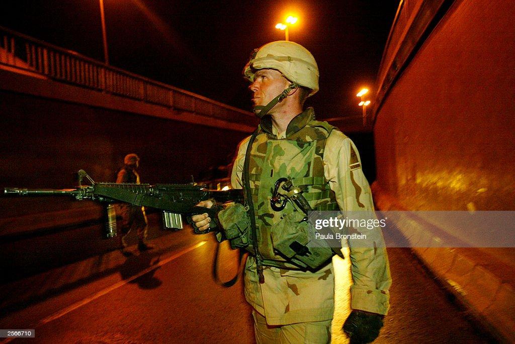 U.S. Soldiers Conduct Night Patrol In Baghdad : News Photo