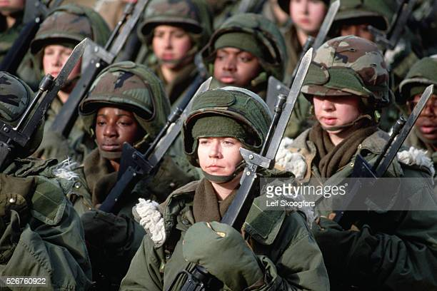 A platoon of female trainees in winter gear marches to the bayonet course during Basic Training In the 1980s to mid 1990s women were trained...