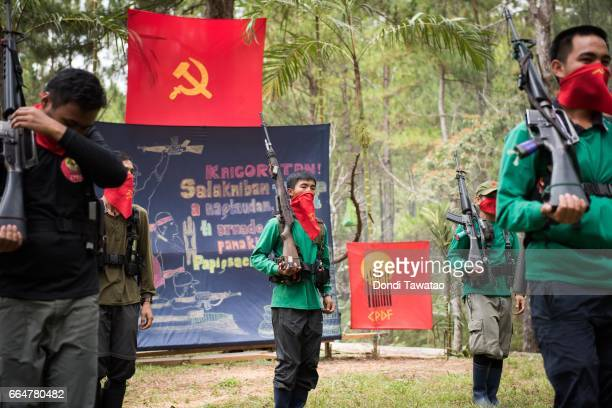 A platoon of guerilla fighters from the Chadli Molintas Regional Command march in formation during simple rites commemorating the 48th year...