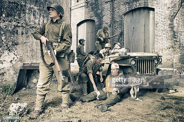 ww2 platoon of notice helping hurt pilot - wounded soldier stock photos and pictures