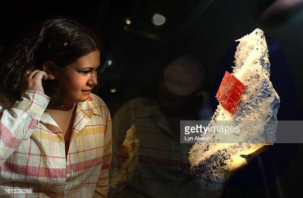 Platte Canyon High School student Christal Ruelas looks at the newly named Colorado mineral rhodochrosite at the Denver Museum of Nature and Science...