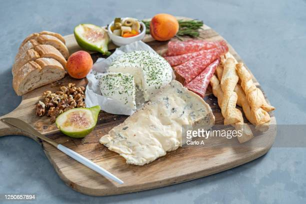 platter of cheese, bread and salami. - antipasto stock pictures, royalty-free photos & images