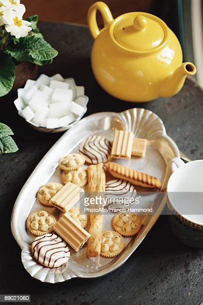 platter of cookies and teapot - sugar bowl crockery stock photos and pictures